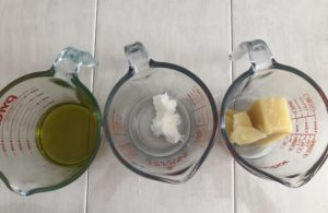 weighing olive oil, shea butter and beeswax for lotion bars